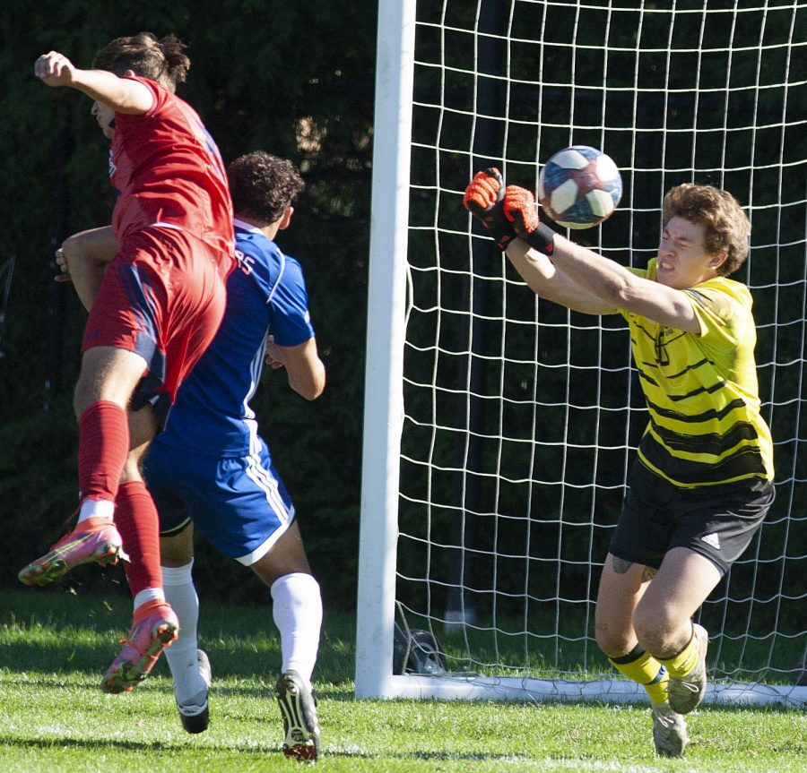 Eastern goalkeeper Mac Van Oudt reaches to deflect a shot in the Panthers 2-0 loss to Belmont Tuesday at Lakeside Field.