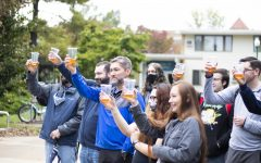 The crowd toasts to the Doug Dibianco floor dedication in front of McKinney Hall Friday afternoon.