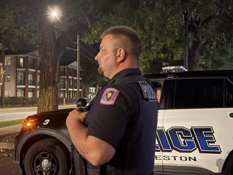 by CORRYN BROCK | THE DAILY EASTERN NEWS Charleston Police Department Officer Brian Siefferman stands watch outside of a of bar after closing. Siefferman served at two departments before coming to CPD.